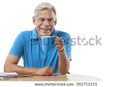 Old man having a cup of tea - stock photo
