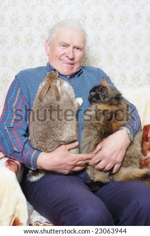 old man hold bunny and cat on the hand - stock photo