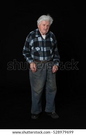 Old man in casual poor clothes full height portrait on dark background
