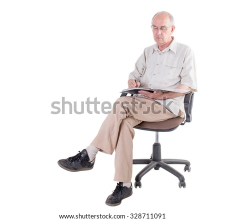 Old man in glasses with folder and pen sitting on a chair. Isolated on a white background. - stock photo