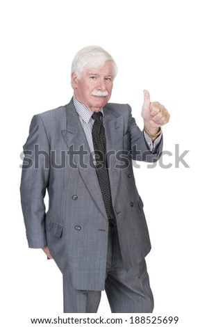 Old man in suit and gray hair looking at the camera and  with one hand showing thumbs up - stock photo