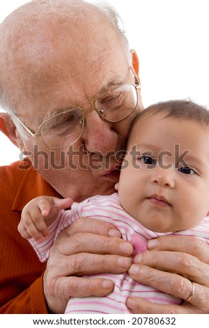 old man kissing the cute baby with white background - stock photo