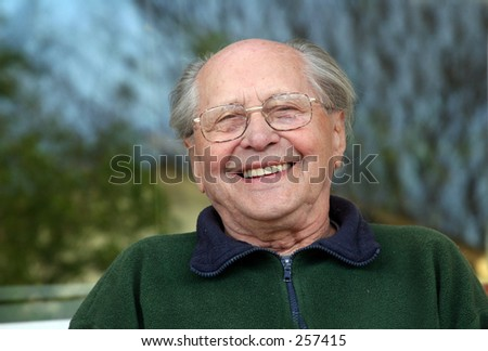 Old man laughing - stock photo