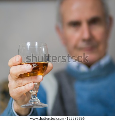 Old man making a toast(drinking) - stock photo