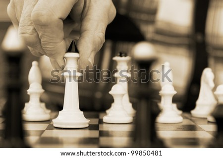 old man playing chess background - stock photo