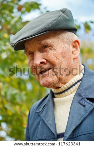 Old man portrait at outdoor shot