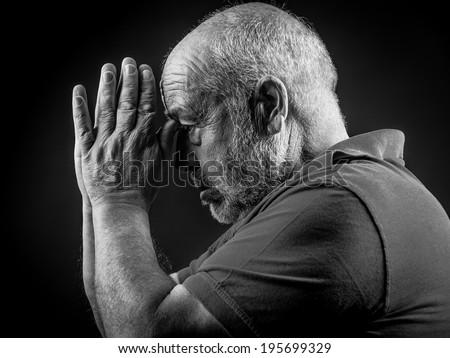 Old man praying - stock photo
