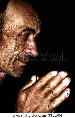 Old man praying,wrinkled and sun burned skin - stock photo