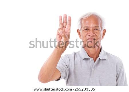 old man raising 3 fingers - stock photo