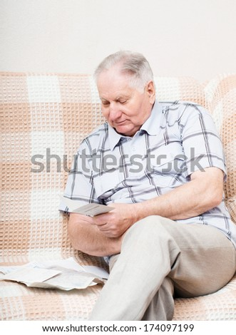 old man reading a document - stock photo