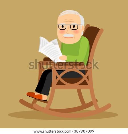 Old man reading newspaper - stock photo