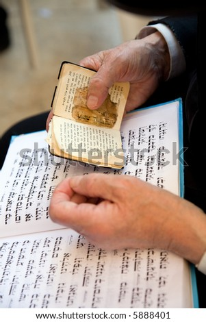 Old man reading Thor in the western wall. - stock photo