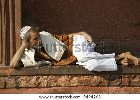 Old man relaxing at Jama Masjid, Delhi, India
