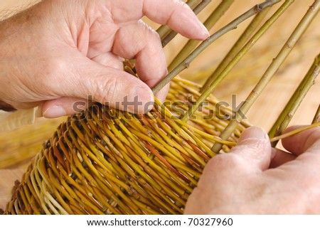Old man's hands and wicker basket