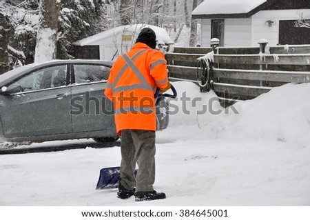 Old man shoveling snow  - stock photo