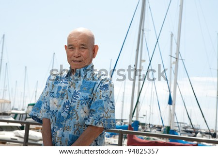 old man standing near harbor
