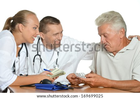 Old man talking with two doctors - stock photo
