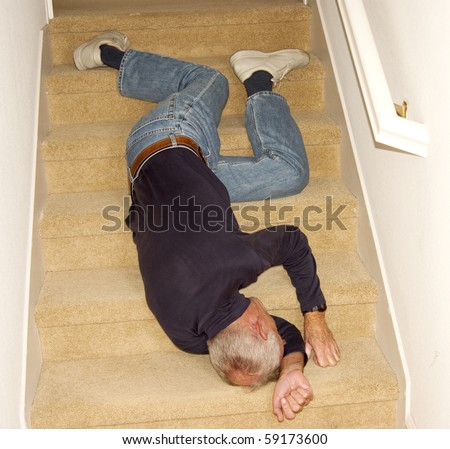 Old man unconscious after falling downstairs - stock photo