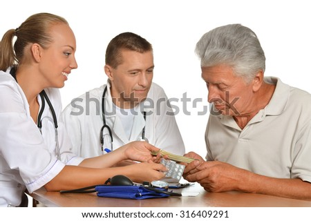 Old man visitting doctors on white background - stock photo