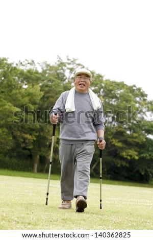 Old man walking - stock photo