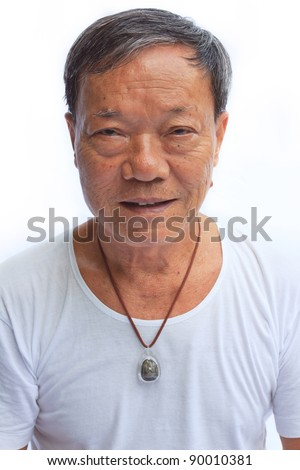 old man wearing a neckless of a buddha statue - stock photo