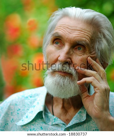 Old man with a beard recollects days of a former youth.
