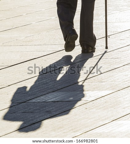 Old man with cane - stock photo