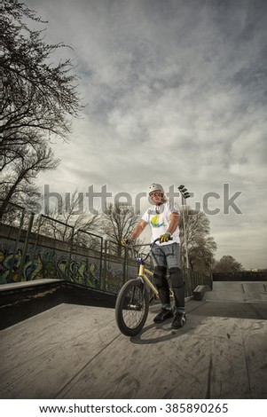 old man with his bike on skate park