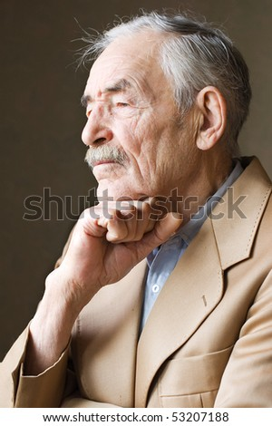 Old man with moustaches in a jacket - stock photo
