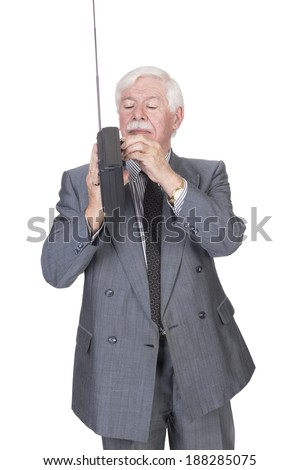 old man with silver white gray hair in a double breasted suit standing fine tuning and  listening to a radio - stock photo