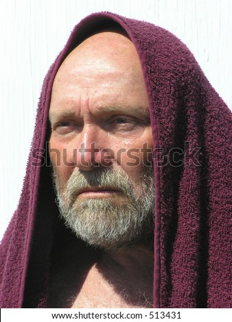 old man with towel over his head - stock photo