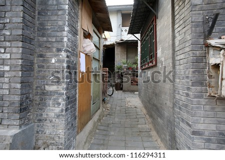 old Manchurian styled buildings and alley ways of over 200 years old in hutong area of Beijing, China. - stock photo