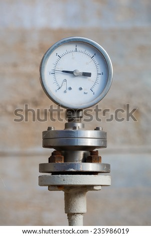 Old manometer on chemical plant - stock photo