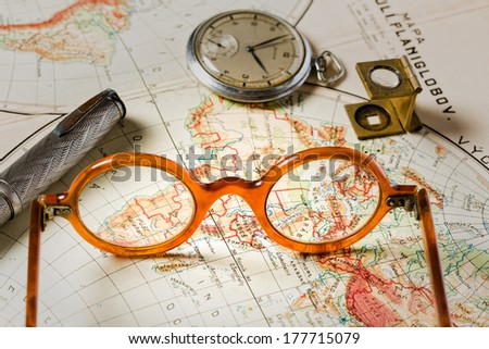 Old maps are large and interesting source of knowledge - stock photo