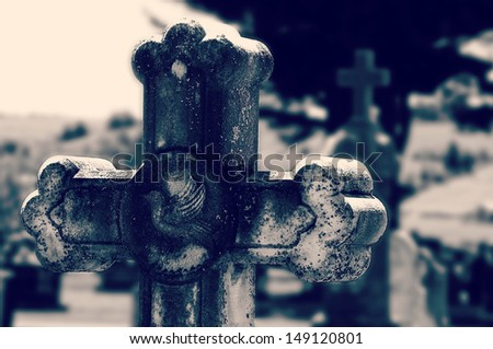 Old marble cross at a cemetery, Quebec, Canada - stock photo