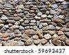 Old masonry made of natural rocks - stock photo