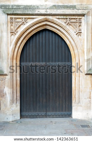 Old massive church door of the catholic church - stock photo