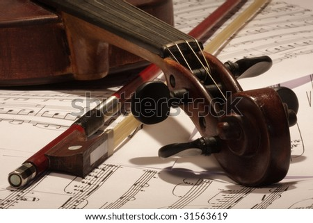 Old master violin with bow and note background - stock photo