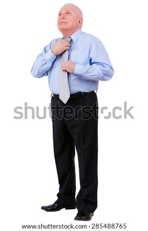 Old mature businessman straightens his tie,  isolated on white background. Human emotion, facial expression - stock photo