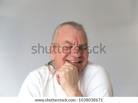 Old mature man laughing and smiling in studio. Happy and healthy