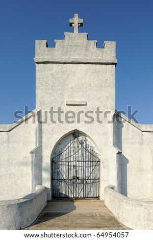 Old mausoleum against clear blue sky - stock photo