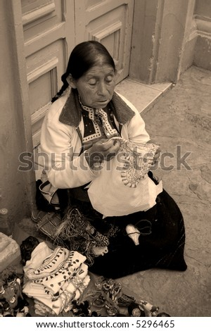 Old Mayan Woman selling shirts on the street