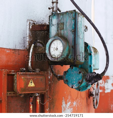 old measuring device on the fuel tank - stock photo