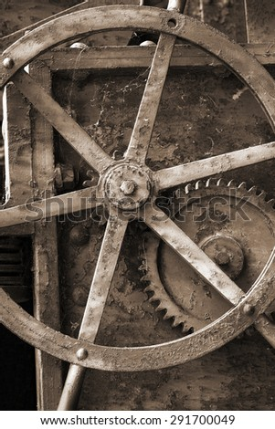 old mechanism with a gear closeup - stock photo