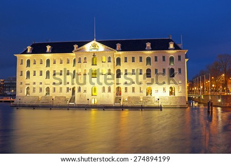 Old medieval building in Amsterdam the Netherlands at night - stock photo
