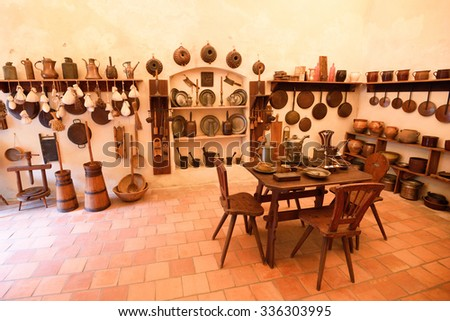 Old medieval castle kitchen with variety of dishes - stock photo