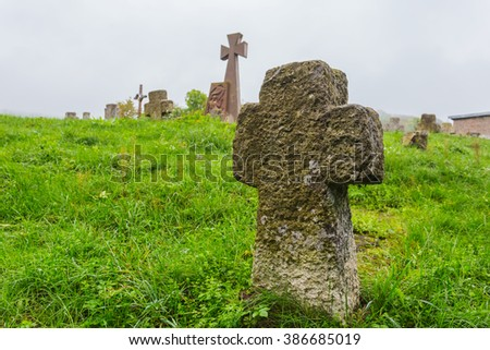 old medieval christian cemetery in a mist - stock photo
