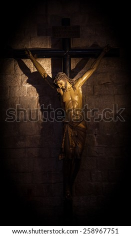 Old medieval crucifix in Italian church - made of wood - stock photo