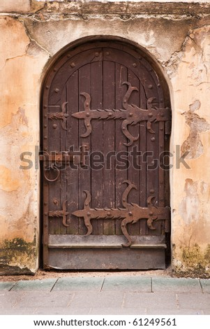 Old medieval door in Vilnius old-town, Lithuania - stock photo