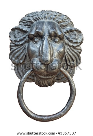 Old medieval iron door knocker in shape of lion head isolated on white background
